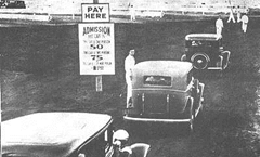 Cars entering an early drive in movie theater