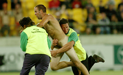 Players tackle streaker at sporting event