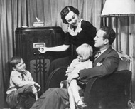 Family listening to early radio